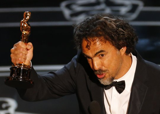 "Director Alejandro Inarritu accepts the Oscar for Best Director for his film ""Birdman"" at the 87th Academy Awards in Hollywood, California"