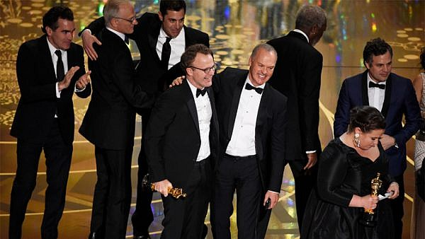 "Tom McCarthy, center left, and Michael Keaton, center right, accept the award for best picture for ""Spotlight"" at the Oscars on Sunday, Feb. 28, 2016, at the Dolby Theatre in Los Angeles. (Photo by Chris Pizzello/Invision/AP)"